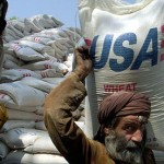 Sacks of American wheat destined for Afghanistan being unloaded in Peshawar, Pakistan.